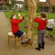 Pupils learning woodcarving